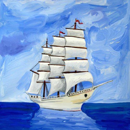 Velero sobre mar azul en calma